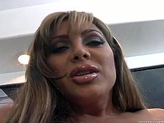 Busty shemale prostitute looks damn feminine. She shows off her curvy body for camera. The she puts anal beats in her ass showing her anus in closeup shot. Later on she gives hot blowjob.