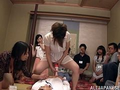 Big-breasted milf Eri Hosaka and her friends are having an indoor party. Eri decides to do a performance and masturbates her twat in the presence of many people.
