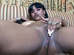 Mind blowing black enchantress takes off her lingerie demonstrating her big natural boobs and juicy ass. Thereafter she provides man with blowjob and titfuck.