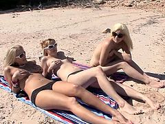 Ariah Sexton and her amazing blonde GF, wearing bikinis, are having fun with a man on a yacht. They drive the dude crazy with a terrific blowjob and ride his schlong by turns.
