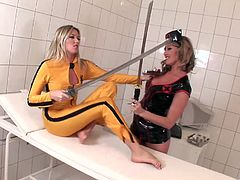 The gorgeous Caroline Cage and Cherry Jul get really nasty as they drill each other's pussies in this sexy Kill Bill parody.