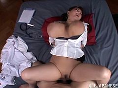 This horny Asian nurse gets a little horny with her patient and ends up getting on top of him to ride his hard cock like a beast.