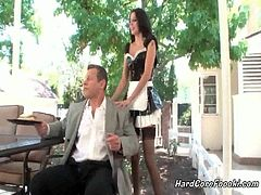 A guy comes to visit a friend and meets his tall and sexy maid. She serves him with something and he asks her to sit in his lap. From there on, he ends up licking her snatch.