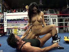 Busty stunner Daisy Marie hypnotizes her opponent with her shapely breasts. Then she knocks him out of his hypnotic trance. She goes to the ground with him and sucks his dick in 69 position. A bit later she fucks him on top. When she feels he's about to cum, she finishes him off with a blowjob.