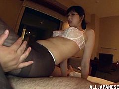 Click to watch this Asian babe, with a nice ass wearing nylon pantyhose, while she gets fucked hard in different positions and moans loudly.
