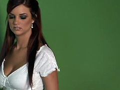 Jayden Cole sits on a chair and checks out the updates from a site. She comments on what has happened there lately. She's wearing a sexy shirt and high heels.