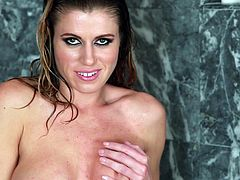 Captivating blonde Randy Moore is getting naughty in the shower. She plays with her beautiful boobs, then smashes her coochie with a dildo.
