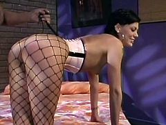 Sizzling hot raven-haired enchantress with juicy booty wearing black fishnet stockings lies on the ebony babe's laps to get her smooth ass spanked well.