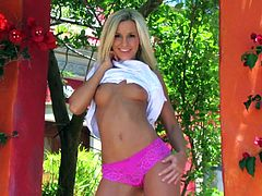 Take a look at Lola Myluv's amazing body in this stunting solo scene where this gorgeous blonde takes off her clothes and fingers herself outdoors.
