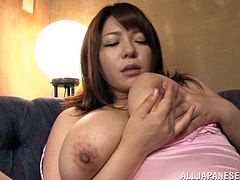 Busty Japanese slut Mizuki Ann, wearing thong, is having a great time alone. She plays with her huge natural boobs and hot pussy, then masturbates her cunt with a dildo.