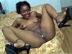 The salacious Ebony babe is getting her pussy drilled as hard as never before. This black bitch with shaved pussy enjoys being sprayed.