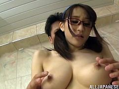 Have a good time watching this Asian babe in pigtails, with huge gazongas wearing a bathing suit, while she goes hardcore in a hot shower.