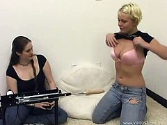 Well-endowed blonde Missy Monroe, wearing jeans, is gonna play with her new toy, which is a modern fucking machine. She strips and stands on all fours and lets her assistant help her with the device.