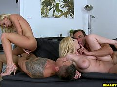 The beautiful Donna Bell and her curvy friend take a hot bath and get their yummy pussies drilled hard in this nasty foursome with two hung dudes.