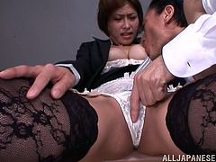 Touch yourself as you watch this Asian brunette, with natural breasts wearing sexy stockings, while she goes hardcore with a business man.