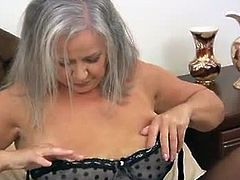 April Thomas is a classy granny with white hair. She purchased a blue vibrator to pleasure herself with and she put on sexy clothes before she started masturbating.