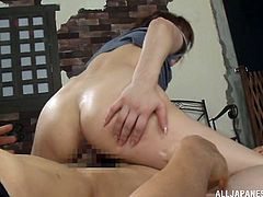 The gorgeous Asian babe Akiho Yoshizaw gets really horny while she works out and ends up getting her sweaty hairy pussy drilled.