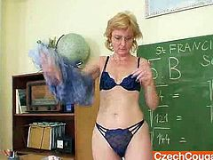 Foxy mamma teacher has on glasses and masturbates herself like crazy in a classroom