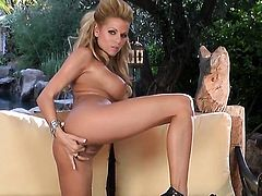 Nicole Graves with juicy knockers and bald muff stripping down to her bare skin