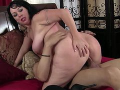 Zesty raven-haired mom with big natural boobs works on stiff dick with her hands and mouth. Thereafter she gets her slit polished by riding that cock in a cowgirl pose.
