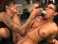 Two kinky tattooed lesbians are having a nice time together. The girls kiss and fondle each other, then lick each other's snatches and smash them with a dildo.