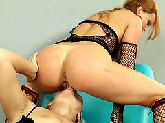 Redhead sexpot Silvia Saint desirably licks soaking pussy of curvy Michelle. Saucy Silvia exposes her booty while facesitting her girlfriend.