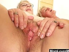 Huge natural tits grannie is very foxy and still orgastic so she seduces another blond gray cougar and they sex each other plus a huge strap on toy