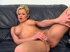 Charming blonde milf Danielle is having a good time indoors. She shows her beautiful boobs and kneads them, then moves her legs wide open and fingers her pussy.