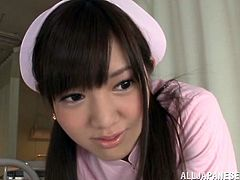 Charming Japanese chick, wearing a nurse uniform, is getting naughty with a dude in a hospital. She licks the man's body and massages his boner ardently.