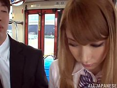 Slim Japanese college girl Sayuki Kanno is getting naughty with a guy in a bus. Sayuki strokes the dude's cock, then sucks it playfully and enjoys it a lot.
