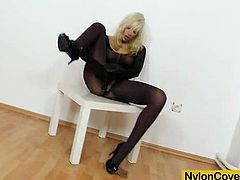 The gorgeous blonde Bella Morgan shows her perfect round ass and enjoys toying her hot little pussy through a hole in her sexy nylon bodyhose.