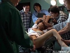 Check this Asian babe, with a nice ass wearing a cute bra, while she goes hardcore in a hospital and plays with a pink toy surrounded by horny guys.