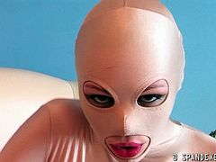 She is wearing a double spandex suit revealing her sexy physique and started teasing and posing for those who have fetish out there. She removes it one by one revealing her beautiful face.