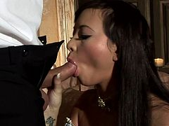 Sizzling hot raven-haired seductress gets seduced by horny bastard. Then she works on his strong prick with her hands and mouth until he cums with pleasure.
