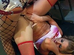 Hot blonde chick gets her cunt played by two horny lesbians in this free sex movie.