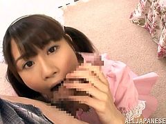 Take a look at this horny Japanese babe in cute dress as she goes down on her knees and plays with an erect penis. She is definitely a ball sucking and cock licking pro.