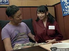 Salacious Japanese waitress Akane Yoshinag is playing dirty games with a guy in a cafe. She kneels in front of the dude and massages his weiner with her big natural boobs.