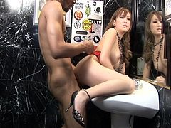 Gorgeous asian temptress welcomes black cock fuck