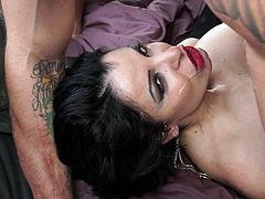 A beautiful cougar with long dark hair, big fake tits and an awesome body enjoys getting her wet pussy and asshole licked.