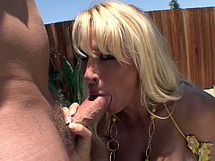 Get a load of Holly Halston's huge round tits as she takes off her bikini before titty fucking and being drilled by a guy with a big cock.