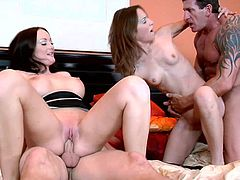 Delectable brunette wench provides cocky bastard with terrific blowjob and rides his strong dick in a reverse cowgirl pose. Other bitch gets her clam poked doggystyle by tattooed man.