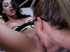 Horny babes Sandy and Breanne Benson get naughty in the office and lick each other's yummy holes in the sexiest 69 ever.