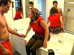 Plump brown-haired hussy Shondra Serandon, wearing a miniskirt and stockings, is playing dirty games with a guy indoors. She pleases the dude with a blowjob, then they fuck in the cowgirl pose on a bed.