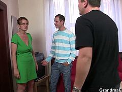 These two guys wake up a mature neighbor. She visits them to argue with them, but they offer her something to drink. She gets drunk and they fuck all her holes.