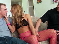Masturbate as you watch this blonde pornstar, with a nice ass wearing fishnet stockings, while she gets pounded hard by two guys in a MMF.