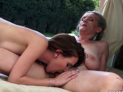 Horny lesbians Aliz and Candy Sweet are having a good time together outdoors. The old woman pleases the girl with cunnilingus, then they finger each other's cunts and enjoy it a lot.