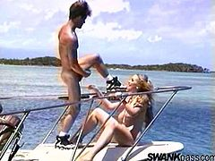 Hypnotized dame with big tits sucks nicely a heavy massive cock before getting hammered doggystyle ontop of a yacht outdoor