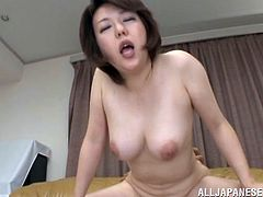 This horny mature Asian woman gets really turned on from getting her delicious cunt licked and ends up taking a hard doggystyle fuck.