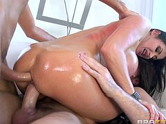 Brunette milf Eva Karera, wearing a corset, shows her big oiled ass to Keiran Lee and Manuel Ferrara. Then she pleases the studs with blowjobs and allows them to drill her holes at the same time.