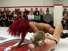 These tough girls are rolling around in the ring and wrestling nice and hard. Three of the dyke wrestlers pin down the redheaded black chick, but the ebony beauty gains the upper hand and jumps on top of them.